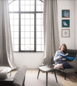 A woman reads a book curled up on a sofa beside a large window in an airy room illustrating the value of images in real estate
