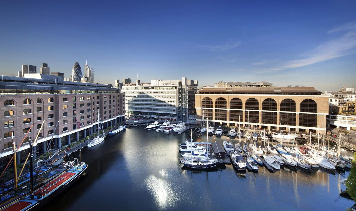 Aerial view of St Katherine Dock in London. Sunny day with blue skies looking over the marina and buildings