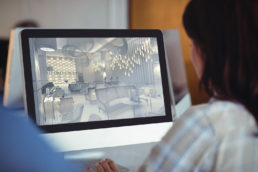 Image of a graphic designed working on a CGI image on a desktop computer