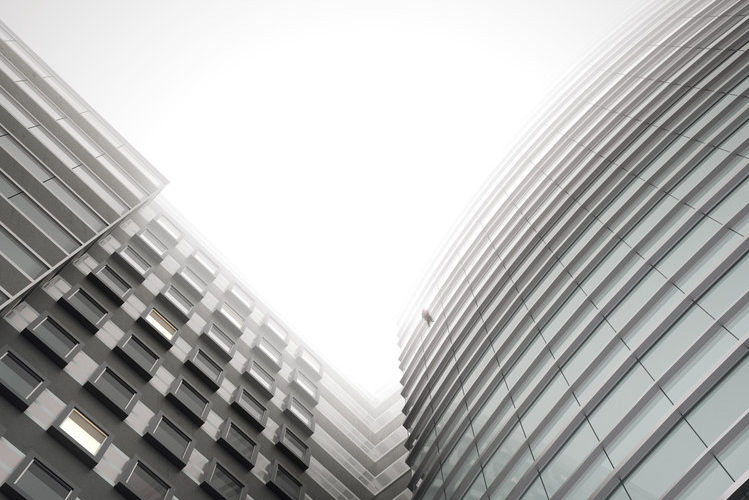 CGI image of office buildings looking up to the grey sky