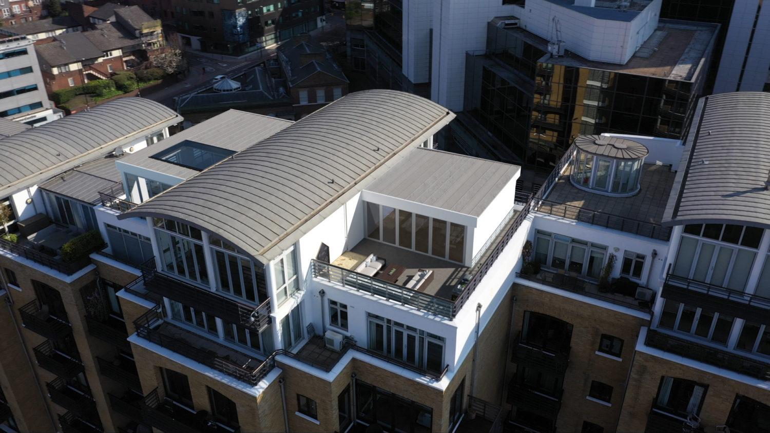 teal court drone shot showing penthouse terrace with CGI extension