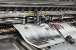 Photograph of a printing press during a print run