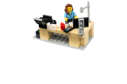 Lego lady at a desk with computer, phone and printer