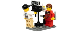 Two lego characters filming
