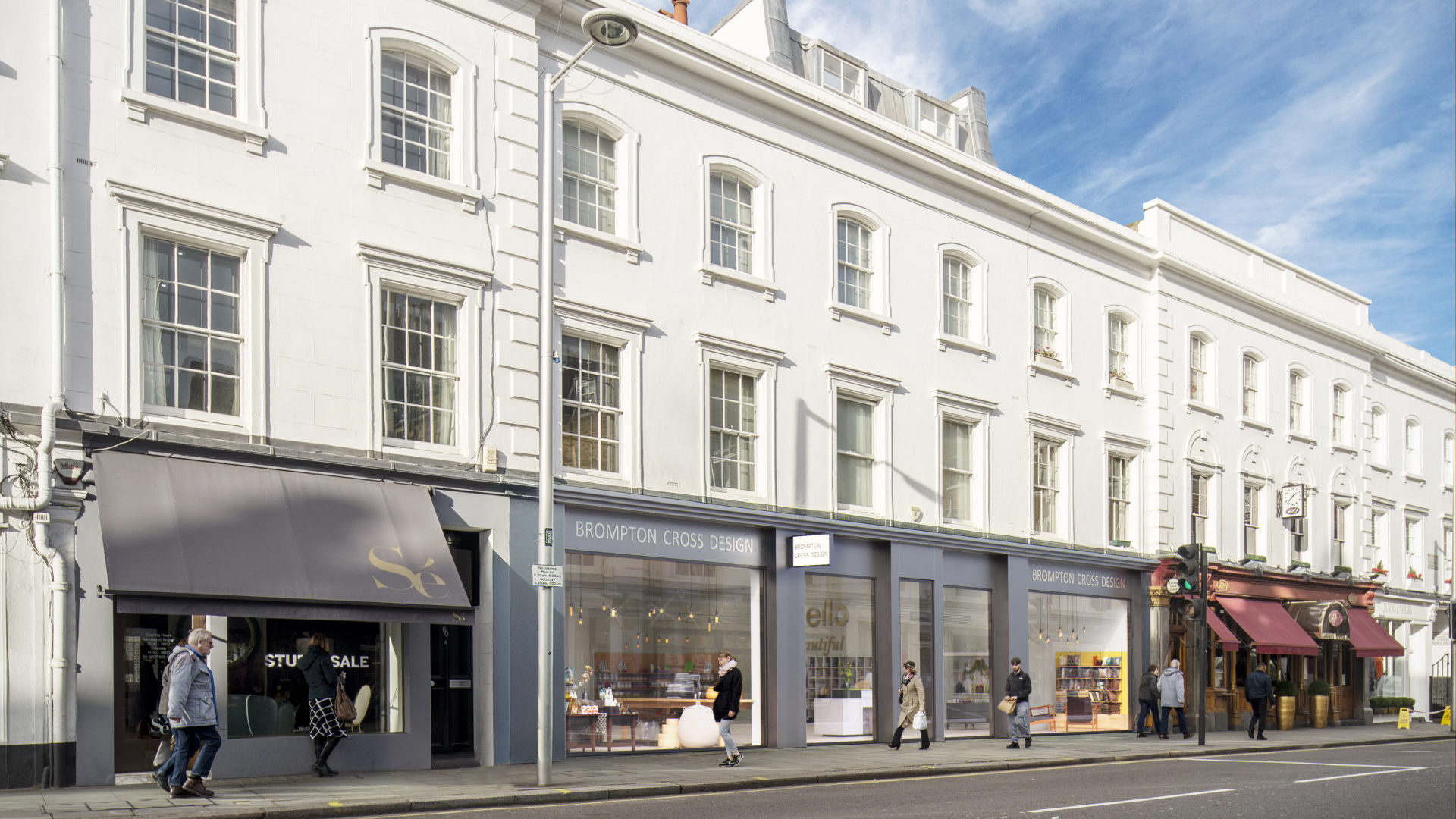 Fulham Road London CGI showing three store fronts combined into one in light grey